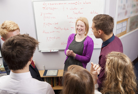 Teacher And Students Talking In Class