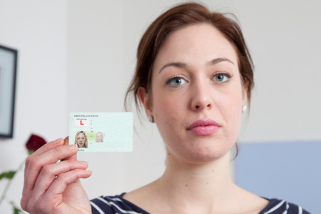 Woman Holding Identification Card