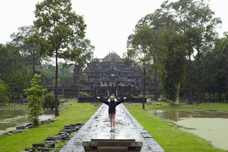 Woman Standing On Walkway To Temple Foto de archivo