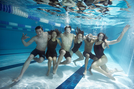 Swimmers Posing Underwater Together