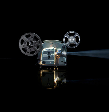 Glowing Movie Projector With Reel Stock Photo