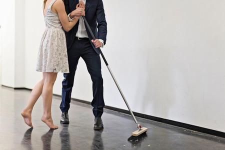 Couple Sweeping Floor Together
