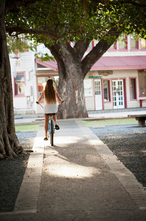 Woman Riding Bicycle In Park Imagens