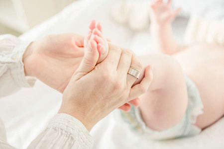 Mother Holding Baby Boys Feet, Close Up