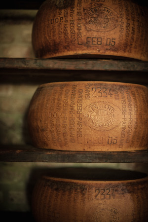 Wheels Of Cheese Aging In Cellar Reklamní fotografie