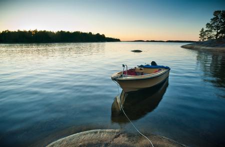 Boat Docked In Still Lake Stock fotó