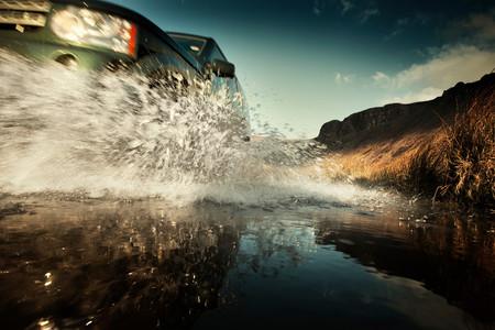 Car Splashing In Still Rural Puddle 写真素材
