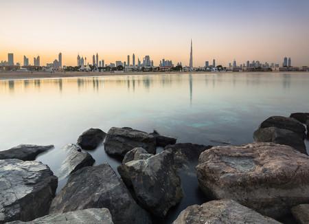 Skyline Of City From Rocky Shore, Dubai, United Arab Emirates Stock Photo