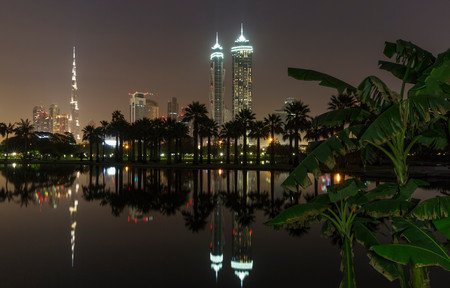 Building Reflected In Lake At Night, Dubai, United Arab Emirates Stok Fotoğraf
