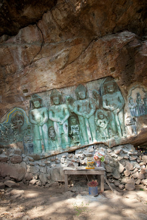 A Buddhist Carving Into A Rockface In Rural Cambodia Standard-Bild - 118070736
