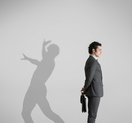 Man With Shadow In Background Dancing Stock Photo