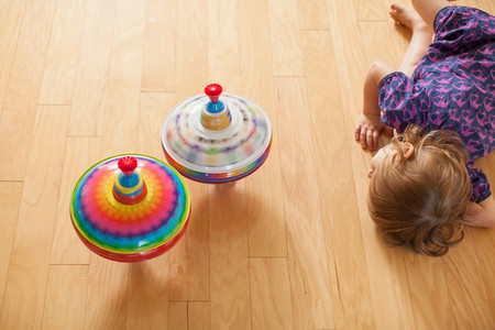 Girl Playing With Spinning Tops