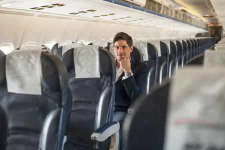 Male Passenger Sitting On Aeroplane