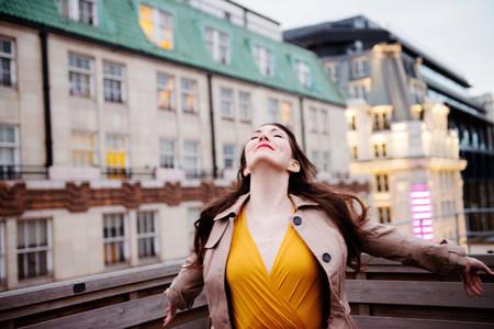 Businesswoman Standing On Urban Rooftop