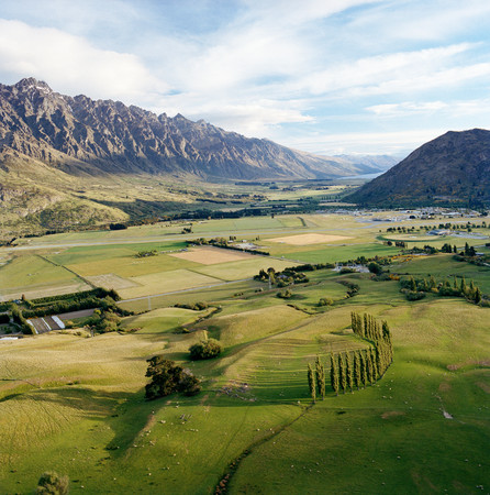 View Across Farmland Towards Southern Alps From Helicopter, Queenstown, Southern Alps, South Island, New Zealand Stock Photo