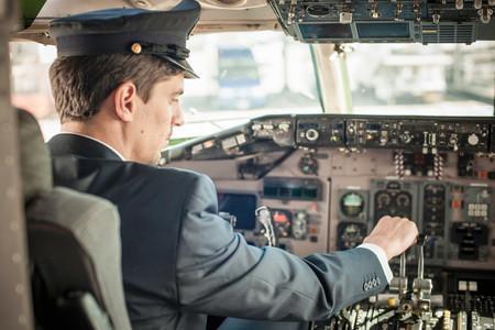Male Pilot In Aeroplane Cockpit Фото со стока