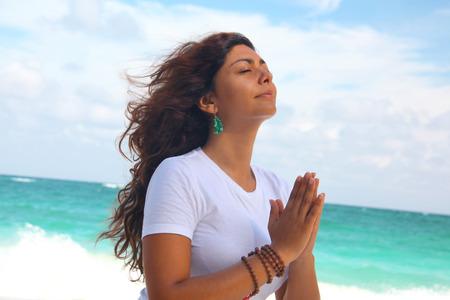 Female Meditating On Beach, Paradise Island, Nassau, Bahamas