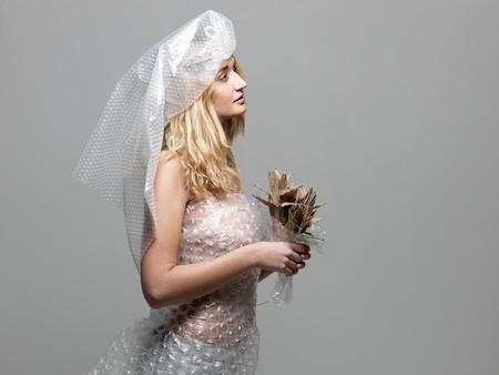 Woman Wearing Bubble Wrap Dressed Up As Bride Foto de archivo