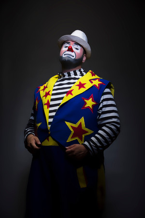 Studio Portrait Of Clown With Hands In Pockets