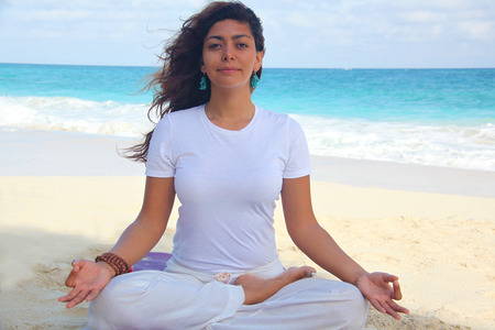 Female Doing Lotus Position On Beach, Paradise Island, Nassau, Bahamas