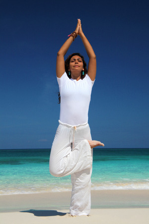 Young Woman In Tree Position On Beach, Paradise Island, Nassau, Bahamas