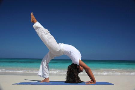 Young Woman Doing Yoga On Beach, Paradise Island, Nassau, Bahamas