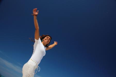 Young Woman Jumping On Beach, Paradise Island, Nassau, Bahamas