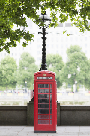 Traditional Red Telephone Box On Embankment, London, Uk Stock Photo