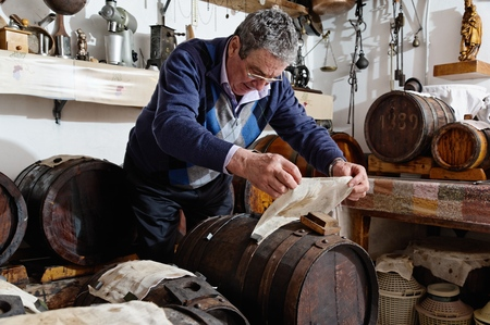 Man Making And Taking Care Over Aceto Balsamico Tradizionale Di Modena