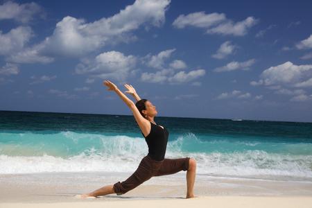 Mature Woman In Warrior Pose On Beach, Paradise Island, Nassau, Bahamas Stock Photo