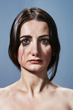 Woman Crying With Makeup Smudges On Face