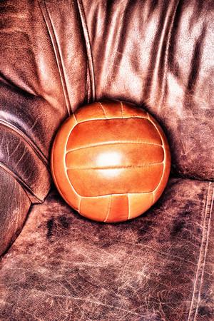 Soccer Ball On Armchair Stock fotó