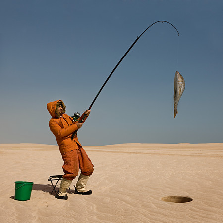 Eskimo Catching Fish In Desert
