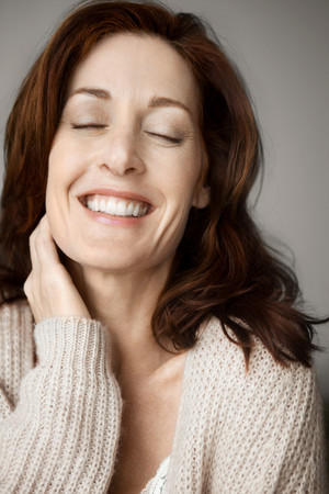 Happy And Relaxed Woman With Closed Eyes