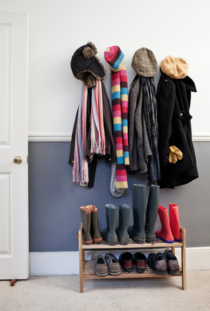 Coats And Hats Hanging On Wall In Hallway