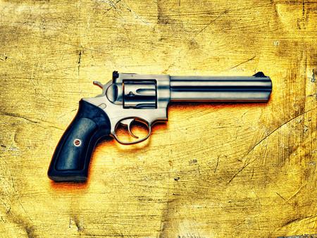 Hand Gun Against Yellow Background Stock fotó