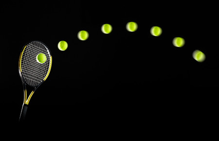Tennis Racket And Balls In Motion Banco de Imagens - 118420850