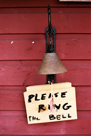 Metal Bell And Sign Saying Please Ring The Bell