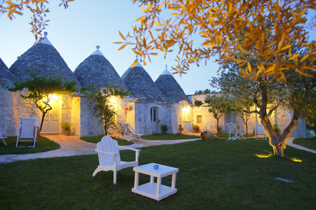 Trulli Houses In Masseria Cervarolo  At Sunset, Ostuni, Brindisi, Puglia, Italy