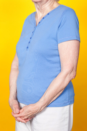 Senior Woman With Hands Clasped, Studio Shot Stock Photo