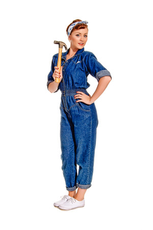 Retro-Styled Young Woman In Boiler Suit With Hammer