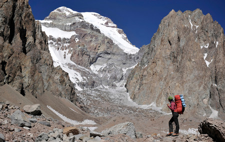 Woman Looks At The East Face Of Aconcagua In The Andes Mountains, Mendoza Province, Argentina Stock Photo