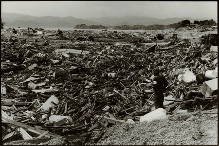 Rikuzentakata, Japan- 20th March 2011: Soldier Amongst Debris In Aftermath Of The 2011 Tohoku Earthquake And Tsunami Editorial
