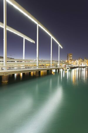 View Of Rambla De Mar And Pier On Port Vell Waterfront At Night, Barcelona, Catalonia, Spain