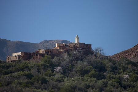 View Of Village And Mosque On Mountain, Atlas Mountains, Morocco 写真素材