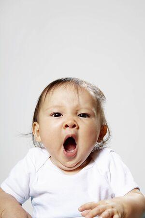 Portrait Of Baby Girl Yawning
