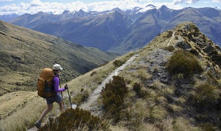 Woman Hiking In Mountains, New Zealand