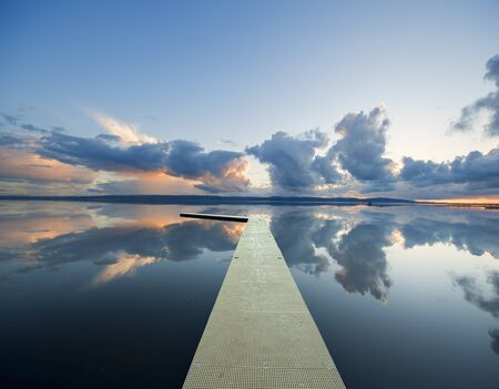 Reflections On Lake With Floating Pontoon, West Kirby, England, Uk 版權商用圖片