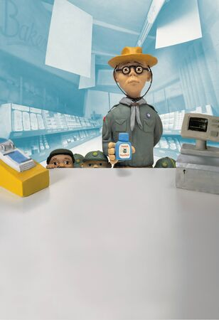Model Of Scout Leader And Scouts Buying Insect Repellent From Pharmacy Counter