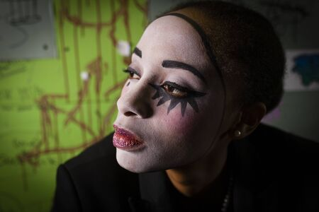 Portrait Of Young Woman With Face Painted As Pierrot
